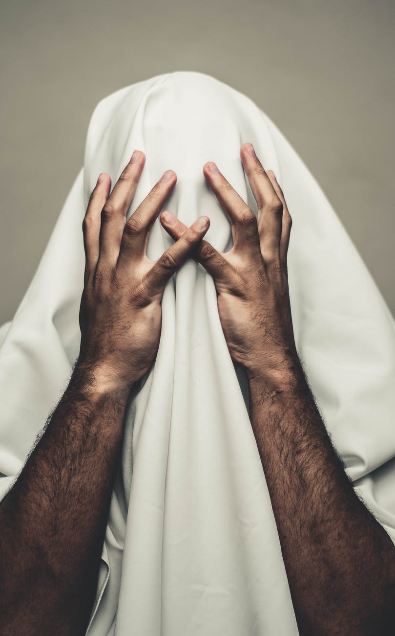person covered with white textile